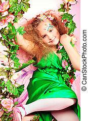green dress - Beautiful little fairy swinging on a swing...