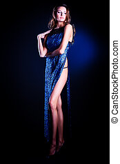 large slit - Full length portrait of a beautiful young woman...