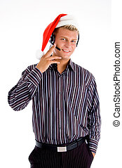 friendly telephone operator with christmas hat on an...