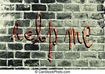 the writing Help Me on the red wall