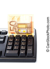 Banknote inserted into keyboard for online payment