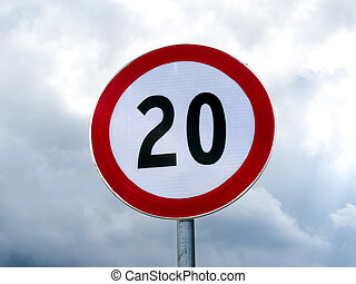 Speed limit sign 20 against cloudy sky