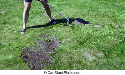 man shorts molehill raker - man in shorts and flip-flop...