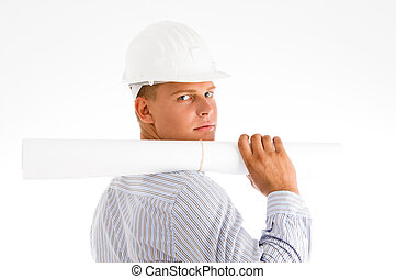 architect looking at camera with blueprints