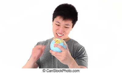 Funny Asian man pointing on a world