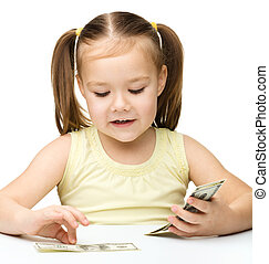 Little girl is counting dollars