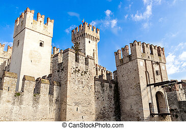 Scaliger Castle in Sirmione, on Lake Garda, is an example of...