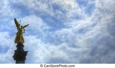 Angel of peace - Time Lapse Angel of peace in front of blue...
