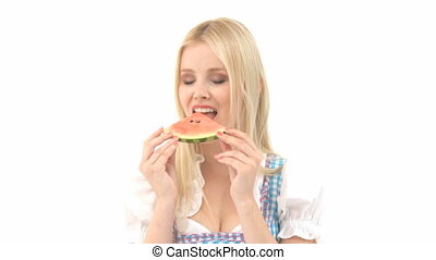 Woman in Dirndl eats Watermelon