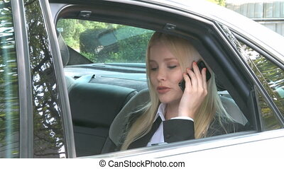 Woman on the phone in a car - Beautiful Woman on the phone...
