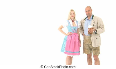 Woman and Man in traditional costumes - Woman in Dirndl and...