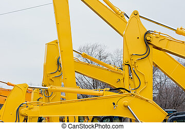 Excavators - Multiple Excavator Boom Arms on Construction...