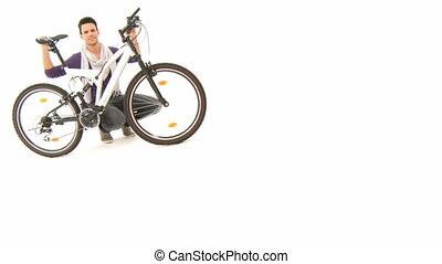 Man with bicycle in front of white background