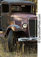 OLD TRUCK IN FIELD - an abandoned old truck in a field