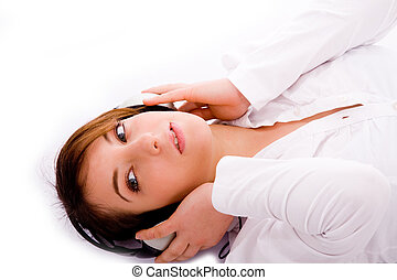 high angle view of woman tuned to music lying down with...