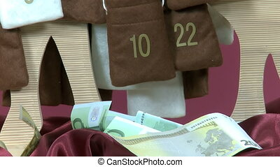 Euro bills out of Advent Calendar - Euro bills are taken out...