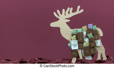 Euro bills in Advent Calendar - Euro bills are taken out of...