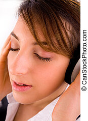 side view of corporate female tuned to music