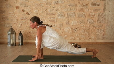 Woman doing Yoga - Woman doing a yoga exercise