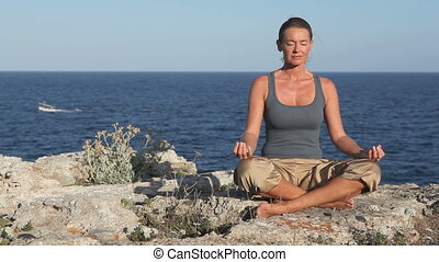 Woman relaxing - Woman relaxes and breathes in and out