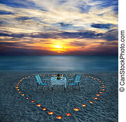 romantic dinner on sea beach with candles - romantic dinner...