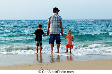 father with son and daughter on vacation at sea