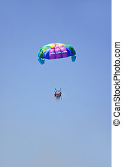 paragliding in the clear sky - colorful paragliding in the...