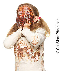 Portrait of a funny little girl with dirty face covered in...