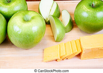 Granny Smiths and Cheese - Cut and whole green granny smith...