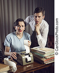 Home Finances - Scared man and woman looking at their bills...