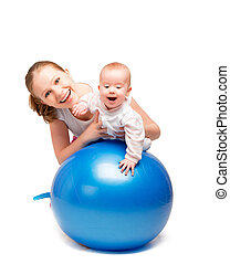 mother and baby doing gymnastic exercises on the ball - A...