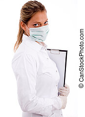side view of medical professional with writing pad and mask