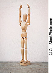 Raising hands up and standing wooden poser