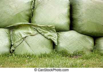 grass wrapped in plastic