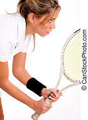 side view of tennis player with racket on an isolated white...