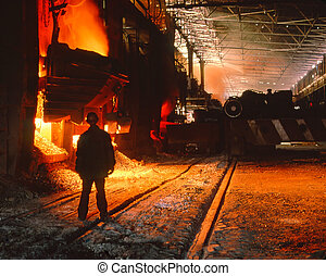 worker on a background of flood of steel