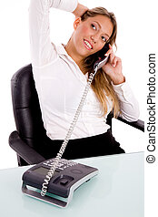 top view of smiling executive talking on phone