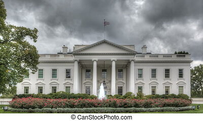 Dark clouds over the White House - The White House with dark...