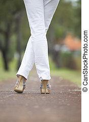 Woman high heels crossed legs outdoor - Woman with crossed...