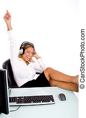 front view of smiling manager listening music in an office