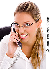 portrait of smiling executive talking on mobile in an office