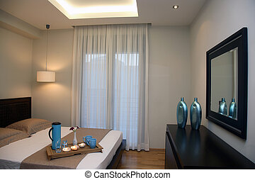 luxury bedroom - interior of a luxury bedroom with double...