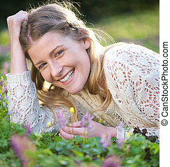 Portrait of a beautiful blond woman smiling outdoors