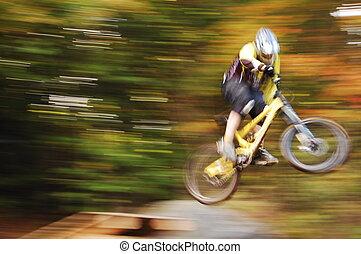 The jump - mountain biker jumping a platform