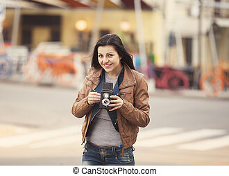 Style teen girl with camera