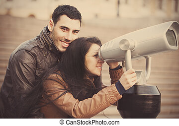 Couple viewing in binocular