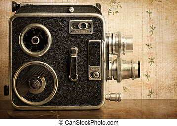 retro - vintage concept with old camera and textured,toned...