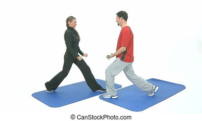 Sport exercise with barbells on a blue mat