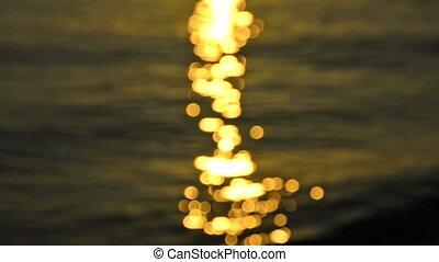 defocused lights of sunrise ocean