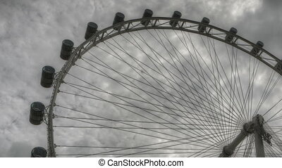Singapore Flyer - Timelapse Singapore Flyer with dark clouds...